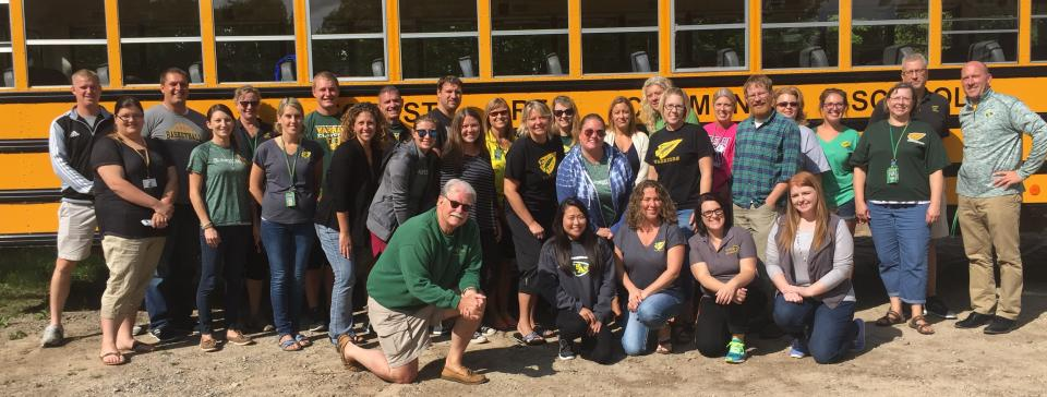Forest Area Staff in front of a school bus